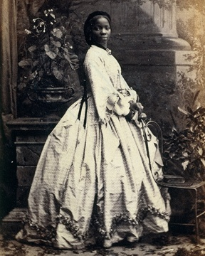 "Lady Sarah Forbes Bonetta Davies. She was born into a royal West African dynasty. When she was around five years old, parents killed in a slave-hunting war. In 1850 Sarah was taken to England and presented to Queen Victoria as a ""gift"" from the King of Dahomey. She became the queen's goddaughter and a celebrity known for her extraordinary intelligence."