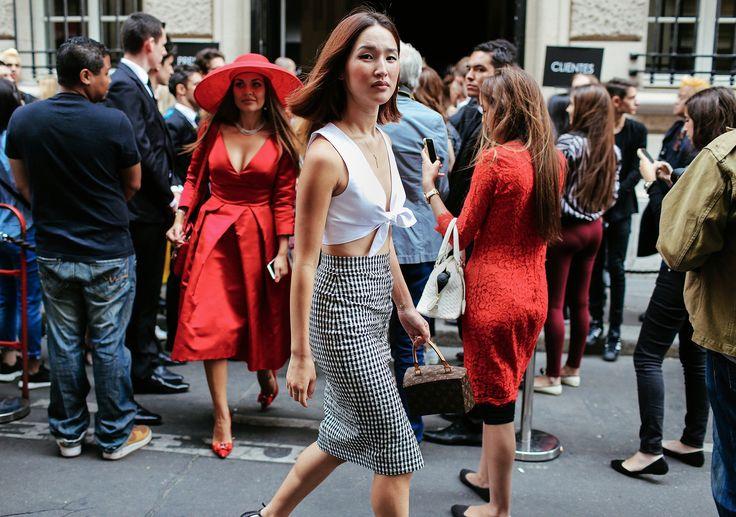 Nicole Warne in an Altuzarra skirt and Louis Vuitton bag