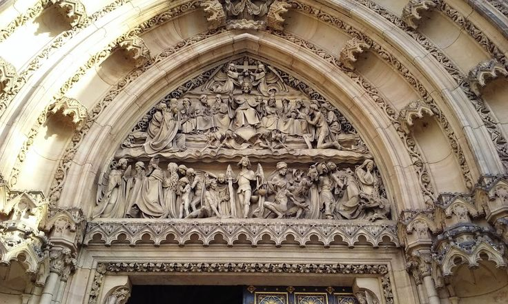 The Last Judgement, as seen on the timpanum over the door of the Basilica of Ss. Peter and Paul in Vysehrad.   Notice the weeping sinners (right) being tormented by demons and dragons, while on the other side the virtuous are welcomed to their eternal reward. In the centre, stands the Archangel Michael, bearing a flaming sword - he's in charge of the sorting - while the four trumpets blast out over his head to announce the coming of the apocalypse. This is Christian art at its most literal.