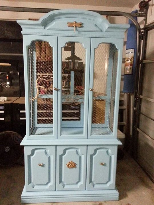 Repurposed old hutch made into a bird cage
