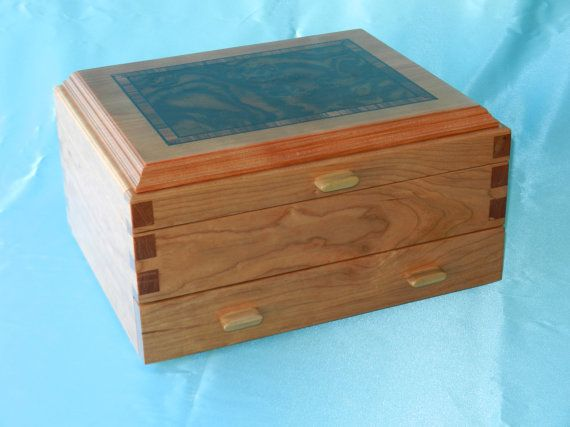 The jewelry box measures approximately 11 3/4 x 9 3/4 x 6. It has a single full width drawer at bottom. It has dovetail joinery that gives it a heirloom