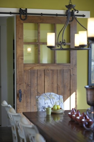 Rustic sliding door and dining light in iron! LOVE!
