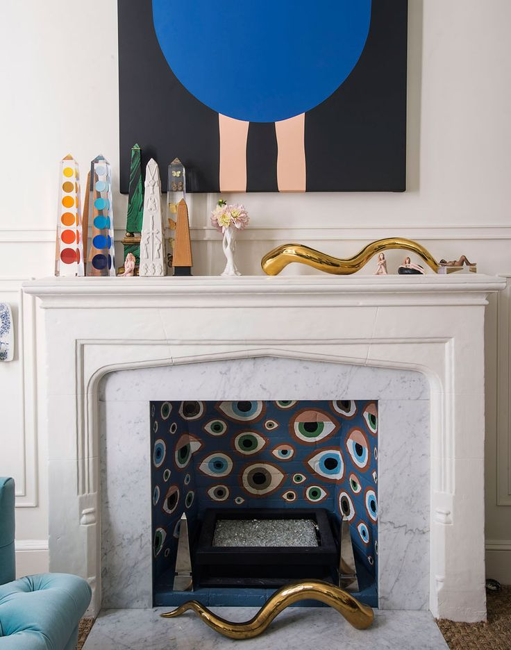 Jonathan Adler and Simon Doonan's eclectic NYC home. Make your fireplace a work of art.
