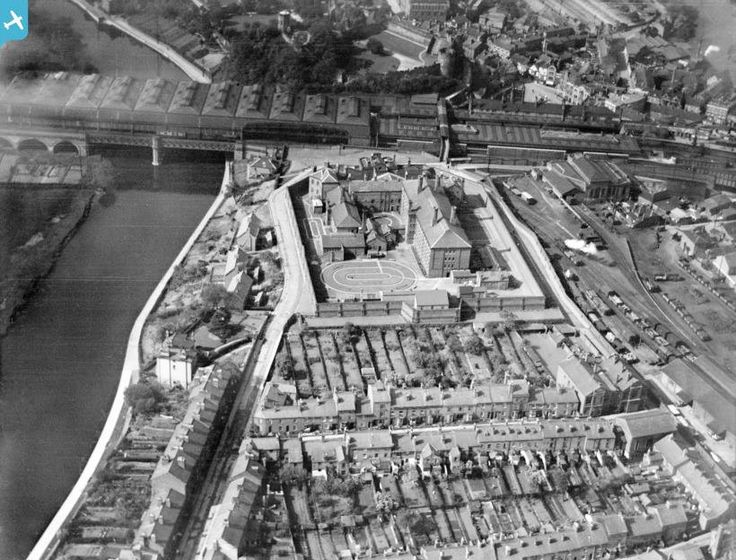 Arial view of The Dana prison 1927.  The River Severn is to the left and the railway and Shrewsbury Castle are in the background