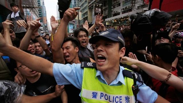 The Beijing government is fighting for control with manipulation; the Hong Kong people are fighting for democracy with peace.