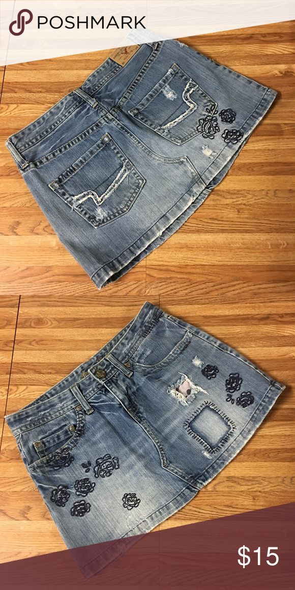 Distressed Denim Skirt American Eagle Super cute distressed style denim skirt from American Eagle Outfitters in a size 2. Please ask if you have any questions, need measurements or more pictures. No trades. American Eagle Outfitters Skirts Mini