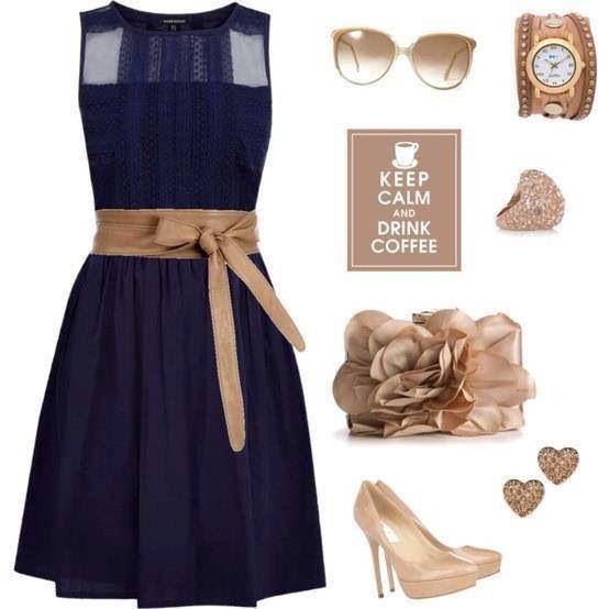 Navy blue dress with beige accessories
