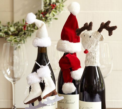 Wine Bottle Accessories | Pottery Barn.  I bought the hat & mittens one yesterday.  Hope I can't think of any one to give it to . . .