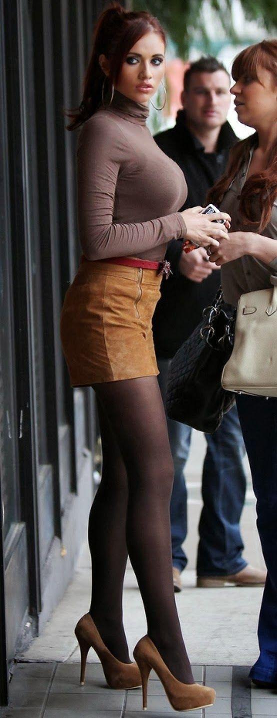her sexy long legs in black hose mini skirt
