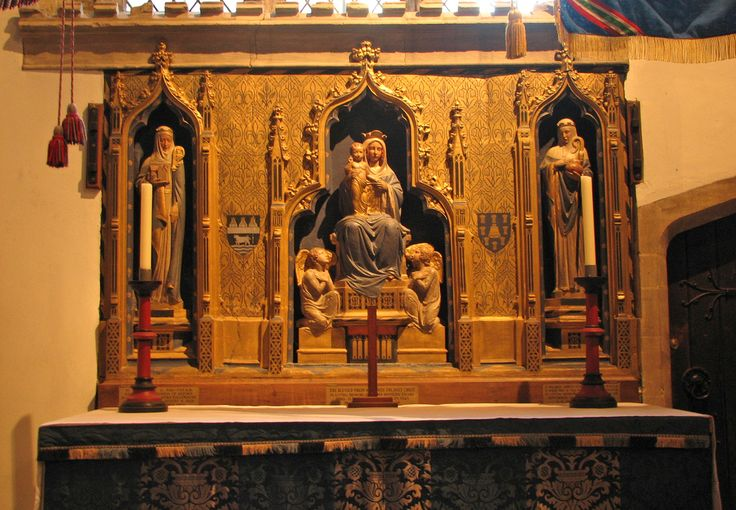 The Lady Altar's niches are from the 14th century but the statues and restoration are Victorian. The heraldic shield on the left of Our Lady is that of the diocese of Oxford.
