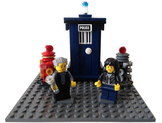This is a Dr Who themed Lego Wedding/Birthday Cake topper featuring your choice of Doctor and Companion Minifigures,Lego Tardis and 2 x Daleks