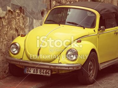 Convertible Yellow VW Beetle - Vintage Tones Royalty Free Stock Photo