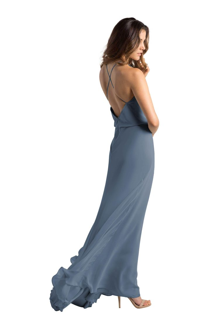A floor-length, cross back chiffon bridesmaid dress in seven colors. Affordable designer bridesmaid dresses to buy or rent at Vow To Be Chic.