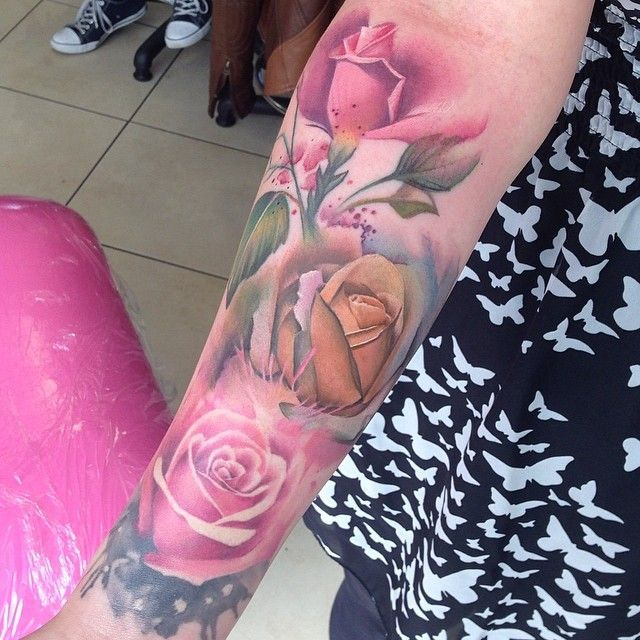 Another watercolor style rose arm tattoo.