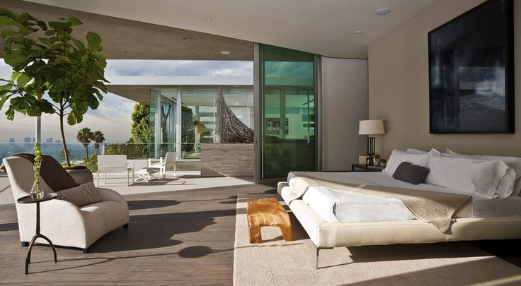 The bedrooms' glass walls pull back for an open-air sleeping experience.  (McClean Design)