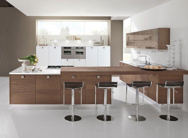 La cucina adele project di cucine lube si articola in un - Altezza pensili cucina da top ...