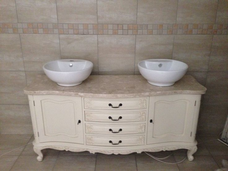 Cream vanity, matches perfect with the tiles