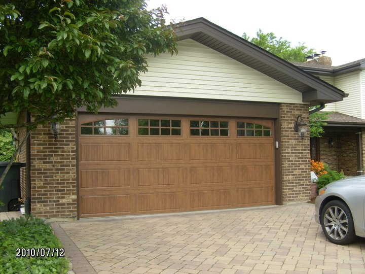Clopay Gallery Collection W Long Panels And Arched Top Section Finish Is Ultra Grain Dark Oak Brown Doors Curb Appeal Door Installation