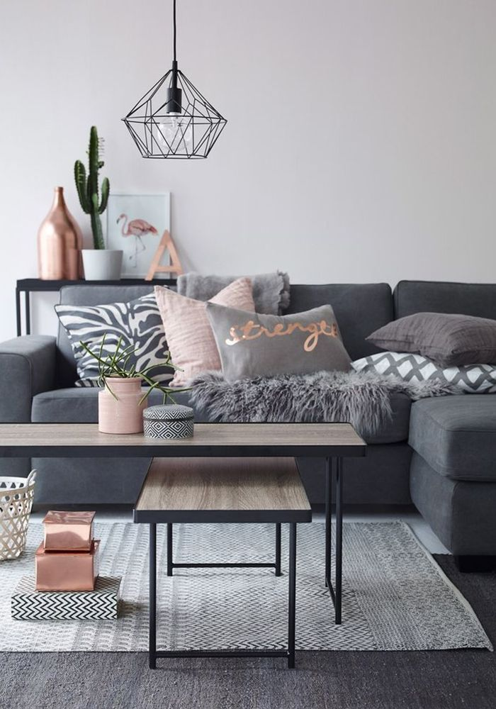 scandinavian style living room idea with grey sofa pink throw pillows modern pendant light and white walls
