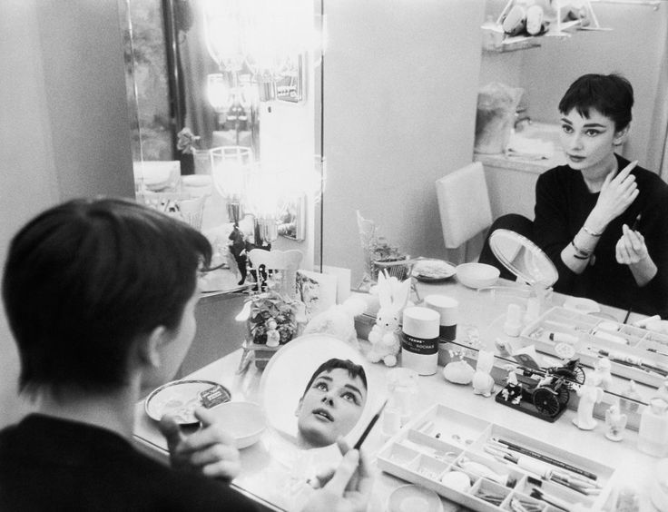 <b>Caption from similar frame in LIFE.</b> Being made up, Audrey has the contours of her eyes skillfully emphasized. They are naturally large, tilted at the corners, with heavy brows.
