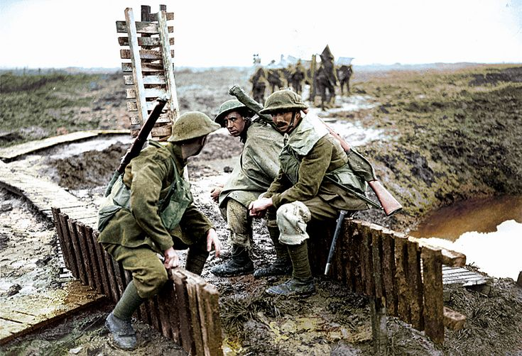 British soldiers rest during the Third Battle of Ypres, Belgium, 1917. Notice the expression of the troopers facing the camera, not to mention the moonscape surrounding the soldiers.