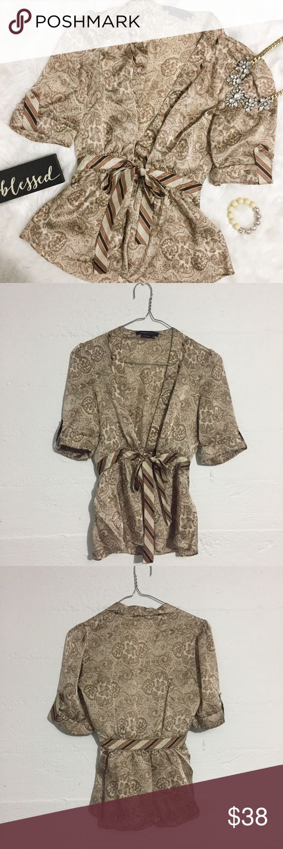 BCBG Max Azria 100% Silk Paisley Tie Front Blouse BCBG Max Azria 100% Silk Paisley Tie Front Blouse would be perfect paired with a Cali underneath and high shine jewelry. Open to offers. No trades. BCBGMaxAzria Tops Blouses