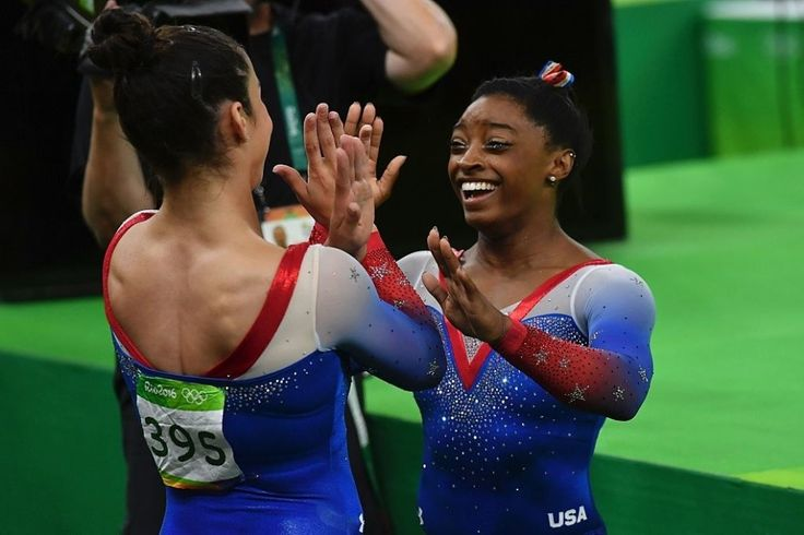 Aly Raisman and Simone Biles coming together after the women's floor event…