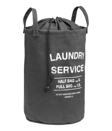 Dark gray. Laundry bag in cotton twill with a printed text design. Top section in lightweight fabric with a drawstring closure. Two handles. Plastic coating