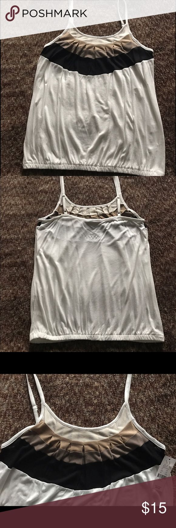 Spaghetti strap tank top New with tags! Never worn! Neutral stripes white spaghetti strap tank top  Perfect for the summer   ☀️☀️☀️  #black #black #beige #white #comfy #cute #summer #tanktop #spaghettistrap New York & Company Tops Tank Tops