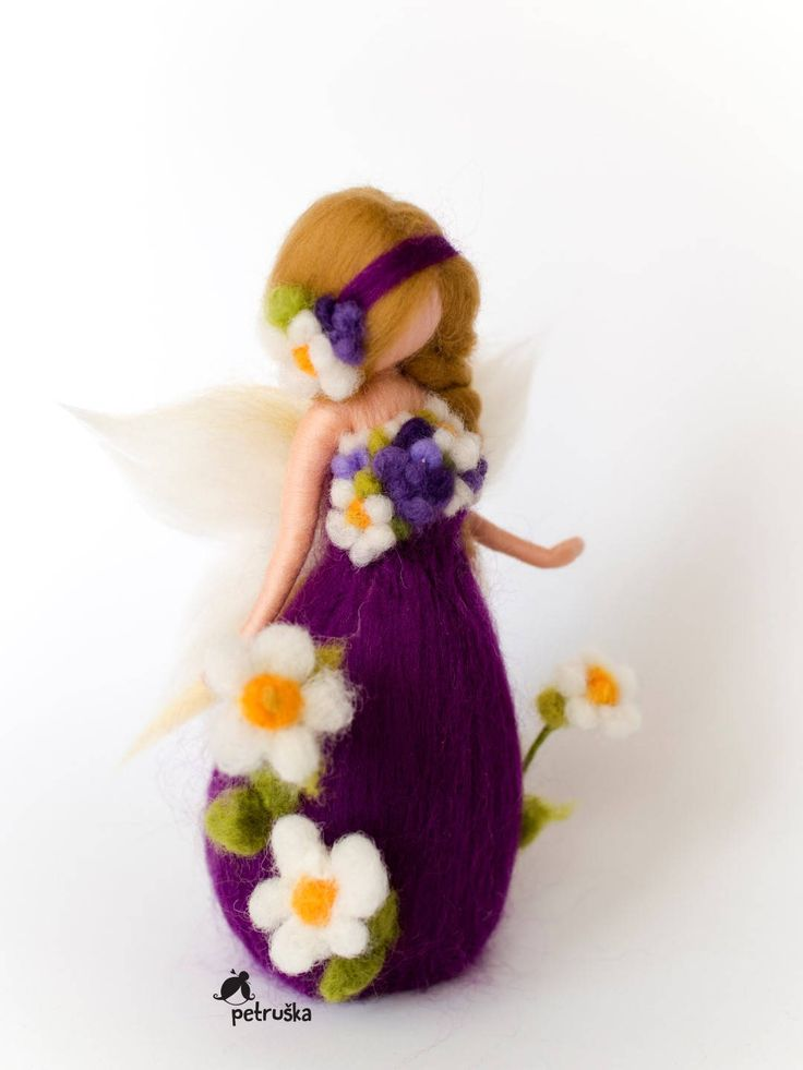 Spring blossom fairy - purple This a fairy from my new spring flower collection, which was inpired after a long grey winter, by magnificent blooming of nature. Spring. Flowers everywhere, flowers in Petruška, flowers in your hearts. The color of her dress is purple, which has a variety of effects on our mind and body, including uplifting spirits, calming the mind and nerves, enhancing the sacred, creating feelings of spirituality, increasing nurturing tendencies and sensitivity, and…