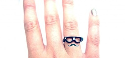 mustache tattoo with glasses ring.