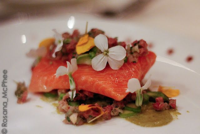 Confit Fillet of trout: delicious veal tartare, smoked English asparagus and  pretty edible flowers by Chef Adam Simmonds