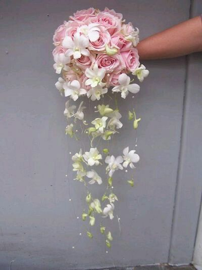 An unusual Wedding shower bouquet with pink rose posy and orchids