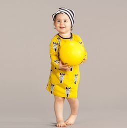 The graphic zebra print and yellow are a great match. Trendy and wonderful to wear! Organic cotton (both dress and cap)