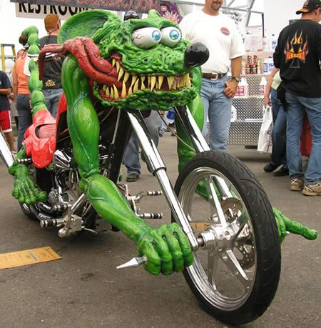This custom bike looks like of like the Rat Fink bike. By Ed Roth it is adorable