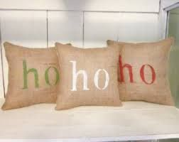 Burlap pillow slipcovers with a stenciled message.