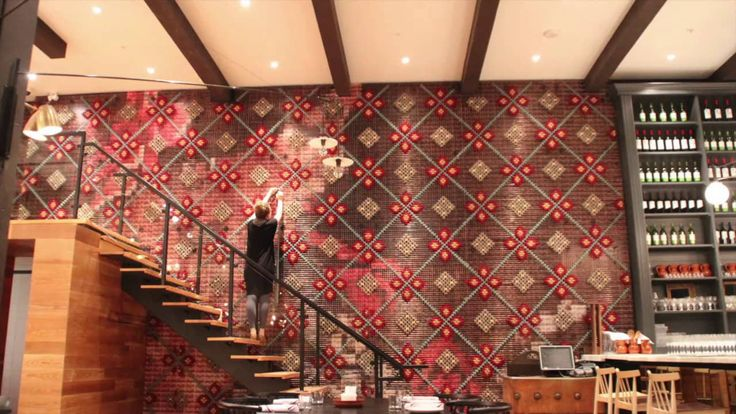 Making of Patria Restaurant cross stitch wall installation
