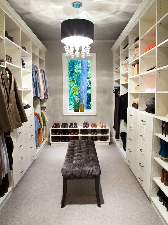 This walk in closet by CLOSET THEORY by Janie Lowrie has lots of easy to duplicate ideas. The basic elements, a bench, stackable shoe racks and stackable drawers can often be found at big box store such as Target.
