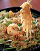 Quick & Easy Pad Thai with Shrimp (gluten-free)  Delicious: shrimp optional, add cole slaw mix with sauce and noodles, add 2 TBS peanut sauce to pad Thai sauce, halve the fish sauce, top with cilantro, green onion, mashed nuts, use 1/2 peanut oil and 1/2 veggie oil, use rice wine vinegar.