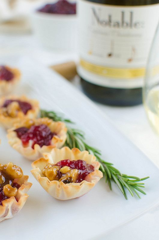 Cranberry Brie Bites - a quick and easy holiday appetizer! Melted