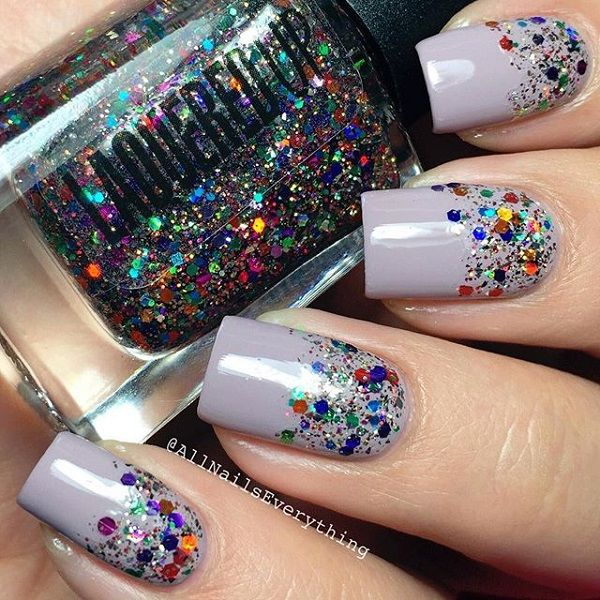 Colorful silver polish and neon sequins and glitter nail art. Unleash those bright colors on your nails by painting on a matte silver polish as base and simply splashing neon colored sequins and glitters on top.