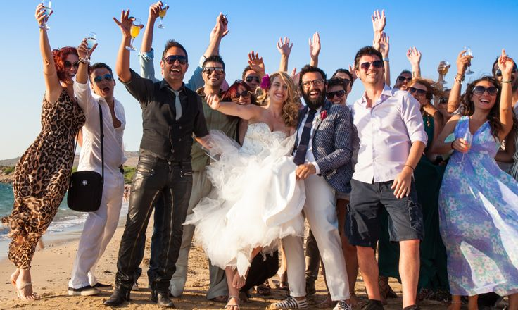 Group photo - Let's say Cheers - Let's say Ya mas in Greek #weddingingreece #beachwedding #weddingphotos 3mythoswedding #kefalonia