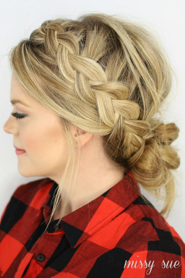 Dutch Braids and Low Messy Bun - this messy bun is to messy for my taste, but i like the interesting way she incorporated the bangs