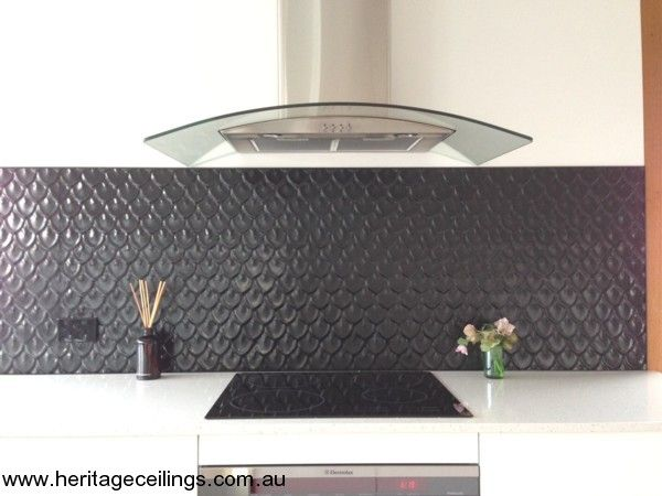 The small fishscale d design was chosen for this divine for Cheap kitchen splashbacks ideas