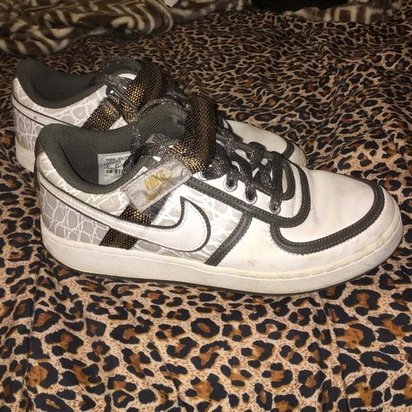 Lightly worn women's Nike sneakers Adorable Nike sneakers. White leather with gold and olive green. Lightly worn. No big signs of wear. Nike Shoes Athletic Shoes