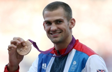 High jumper Robbie Grabarz shows off his bronze medal for highjump