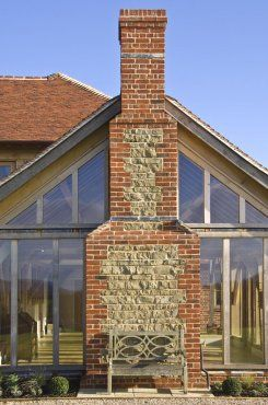 Glazed oak gable with traditional brick and stone chimney