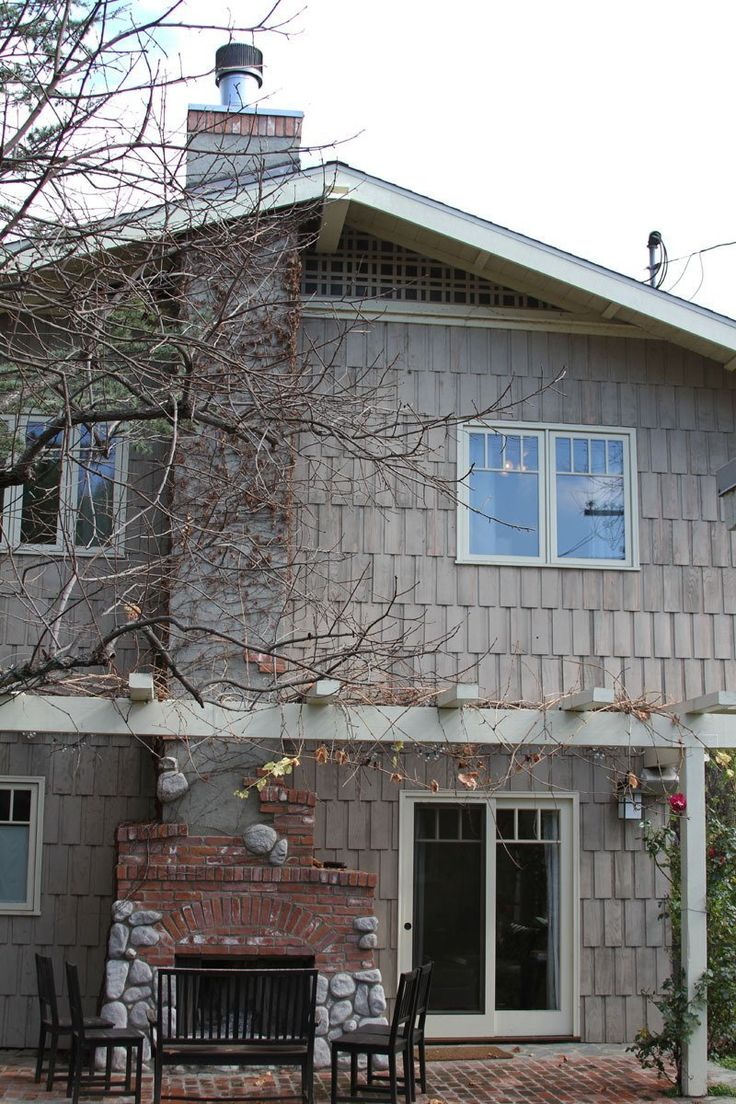 California Craftsman...Things I like: 1. fireplace surround with brick and stone, 2. evenly-space, stained siding, 3. Craftsman lines...