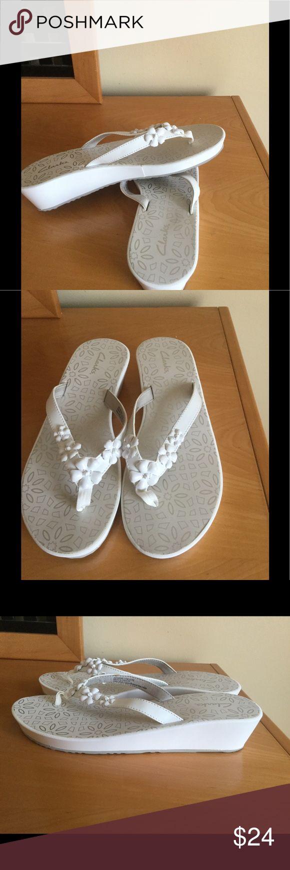New Clarks white wedge flip flops New Clarks white flip flops . Man made upper .No box ❌Price firm Clarks Shoes Sandals