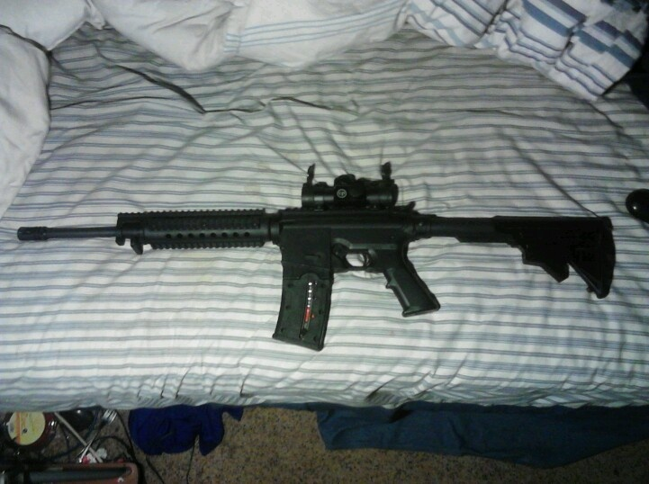 Flat top with a red dot, ajustable stock, 25 round clip, and tac rails!